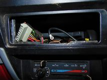 No Radio. Dashboard of car where radio should be, only wires Stock Images