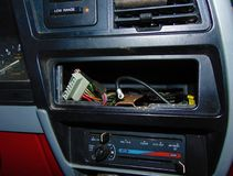 No Radio. Dashboard of car where radio should be, only wires Royalty Free Stock Image