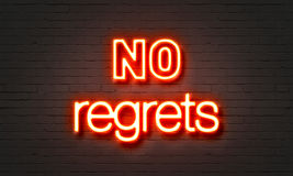 No regrets neon sign on brick wall background. Stock Image