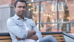 No, rejecting young african man sitting on bench stock footage
