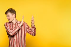 No rejection discard refusal man turn down gesture. No thank you. rejection discard refusal. man turning down smth with a hand gesture. portrait of a guy on stock photography