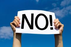 No, rejection sign. Hands holding paper with text royalty free stock images