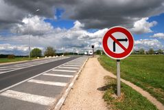 No right turn. Sign on a French road under a cloudy sky Stock Images