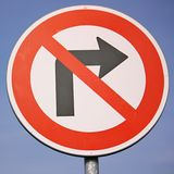 No right turn traffic sign. Against blue sky Stock Photo