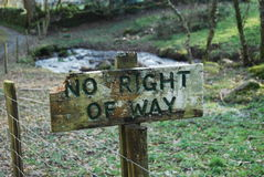 No right of way sign. Weathered sign on woodland path Stock Photos