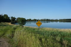 A no road maintenance sign beside a lake Stock Photo