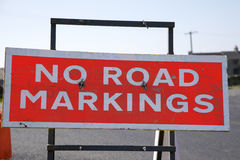 No Road Markings Sign. A bright, red no road markings sign Royalty Free Stock Photography