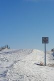 No Through Road Sign. On Snow Covered Country Road royalty free stock photography