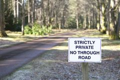 No through road strictly private road sign at entrance to estate grounds of woodlands forest lland andmark. No through road strictly private road sign at stock photo