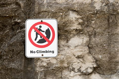 No Rock Climbing Danger Sign on Cliff Stock Photos