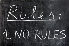 No Rules on Chalkboard. Rules list with one only rule: no rules handwritten with white chalk on dirty blackboard. Please visit my personal blackboard collection Royalty Free Stock Photo