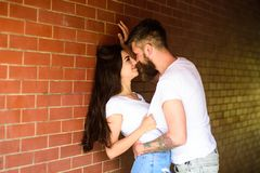 No rules for them. Couple enjoy intimacy without witnesses public place. Girl and hipster full of desire cuddling. Couple in love full of desire brick wall royalty free stock photos