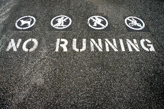 No running. Sign painted on the ground Royalty Free Stock Image