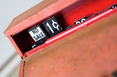 No sale. An antique register with NO SALE and one cent in the window royalty free stock photos