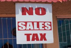 No Sales Tax Sign. A sign on a clothing and apparel store advertises that shoppers can buy items free of tax stock image