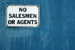 No Salesmen 2. A No Salesmen sign on a weathered blue door Royalty Free Stock Image