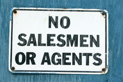 No Salesmen 3. A No Salesmen sign on an aged blue background Royalty Free Stock Photography