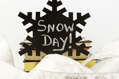 No School on black snowflake in white ribbons and books Royalty Free Stock Image