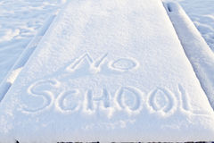 No School, two words outlined in snow. No School carefully printed in fresh snow indicates winter weather has closed local schools Royalty Free Stock Images