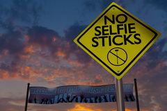 No selfie sticks sign at a music festival. stock images