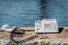 No service. View of on old phone ,sea background Stock Photos