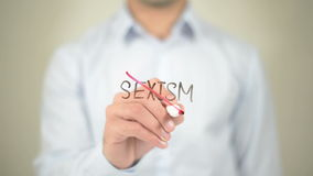 No Sexism,  Man writing on transparent screen stock footage