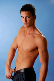 No Shirt. A handsome muscular young man without a shirt Royalty Free Stock Photo