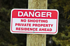 No shooting sign indicating private residence ahead.  royalty free stock photo