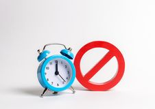 No sign and blue clock on a white background. Unavailability at certain hours. Temporary restrictions and prohibitions. Restrictions and sanctions, strict stock photos