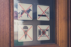 No sign, no dogs, no smoking, no photo, no icecream signs on doo Stock Images