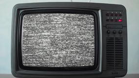 No signal just noise on a small TV in a room. Static noise on a vintage TV set in a room stock video footage