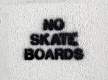 No Skate Boards. Words stenciled on a wall next to some stairs that must have been tempting to skate boarders Royalty Free Stock Photo
