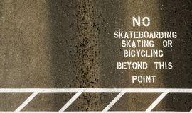 No skateboarding sign painted on footpath Stock Photography