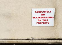 No skateboarding sign on wall of building. Stock Images