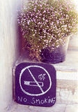 No smoke sign in hand drawing with gypsy flower Stock Images