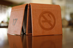 No smokiing. A no smoking sign in a table Royalty Free Stock Photography