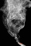 No smoking. Appearance of cigarette smoke forming the shape of a skull Royalty Free Stock Images