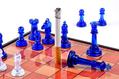 No smoking. A chess board showing the danger of smoking Royalty Free Stock Images