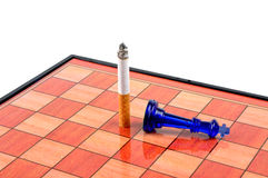 No smoking. A chess board showing the danger of smoking Stock Photo