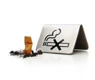 No smoking. Cigarette next to no smoking symbol Royalty Free Stock Images