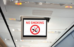 No smoking!. This photograph represent an overhead no smoking sign on a plane Stock Images