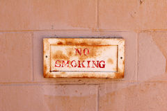 No smoking. Old no smoking sign on a painted wall Stock Photos