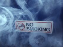 No smoking. Sign engulfed in smoke Stock Photo