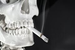 No smoking. Smoking sceleton on black background royalty free stock image