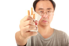 No smoking. Man crashing a pack of cigarettes on white background Stock Photos