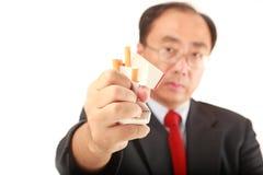 No smoking. Man crashing a pack of cigarettes on white background Stock Images