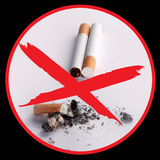 No smoking. Icon - butt, cigarette on black background Stock Photography
