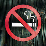 No smoking. Sign on wooden surface Royalty Free Stock Photos