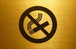 No smoking. A gold no smoking table in a hotel Royalty Free Stock Image
