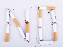 NO SMOKING. Inscription made of torn cigaretts Royalty Free Stock Image